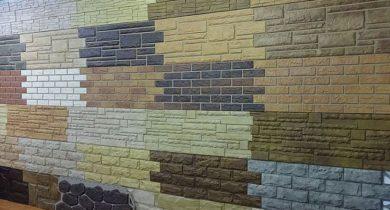 облицовка фасада дома пластиковыми панелями под камень фото